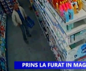 Prins in flagrant in timp ce fura din supermarket - VIDEO
