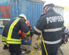 Accident de munca in Capitala! Barbat prins sub un container - FOTO