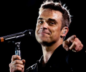 PREMIERA:Robbie Williams vine in Romania